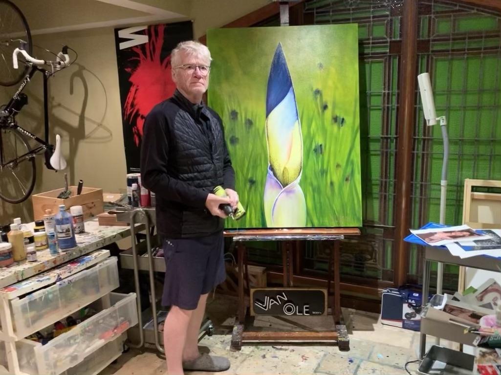 Picture of artist Derek Olson in his studio